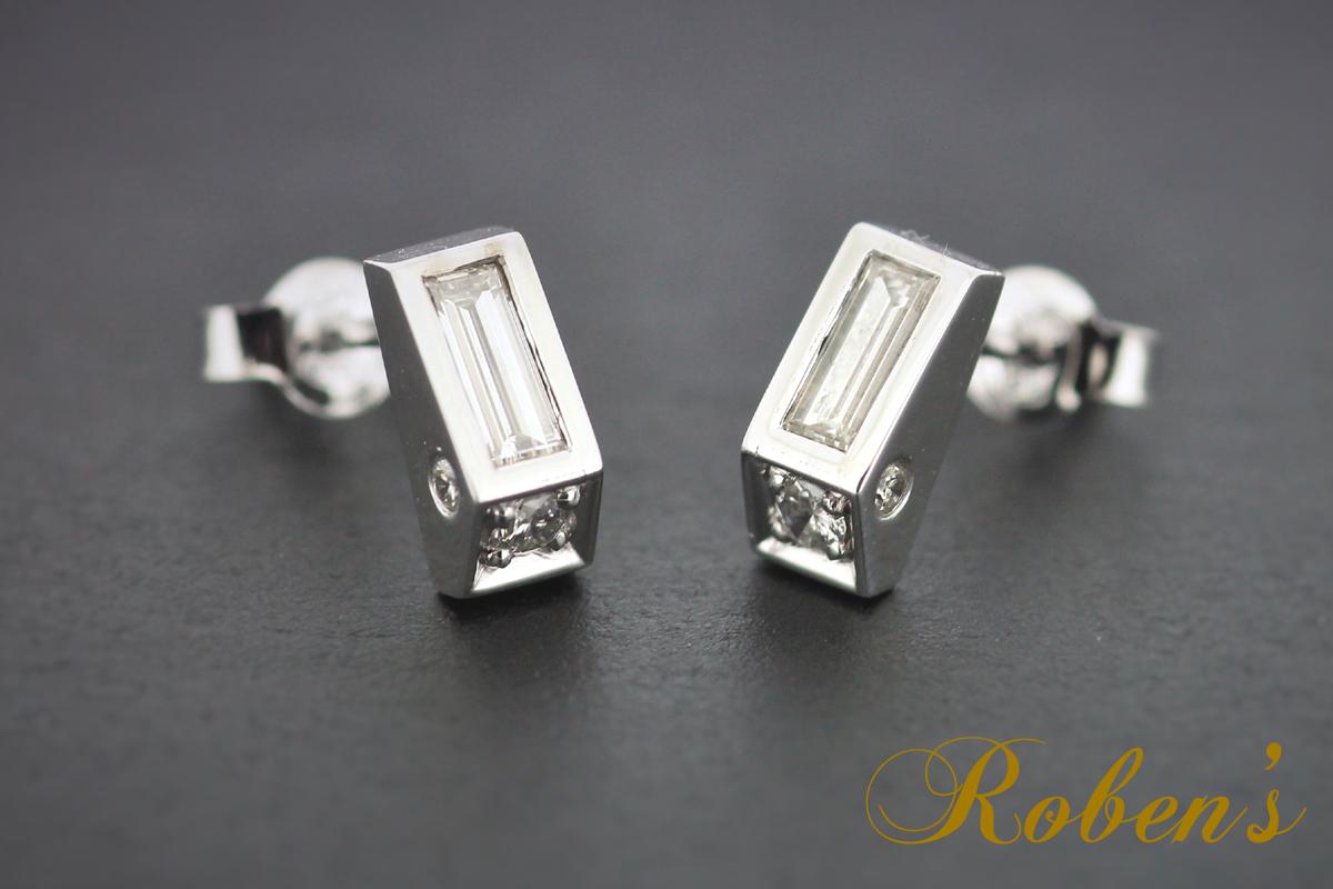 Platinakorvakorut, joissa baguette-timantit ja timantteja