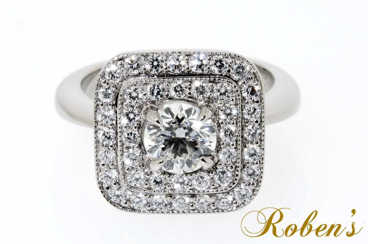 Valkokultainen timanttisormus